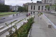 Nous avons participé au projet de réaménagement de la Place Vauquelin au Vieux-Port de Montréal. #accessibilité #DesignUniversel Place, Sidewalk, Design, Puertas, Side Walkway, Walkway, Walkways, Pavement