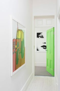 Eye-Catching Bold Doors - white walls & floor, traditional style door & frames, lime door complemented by the modern artwork