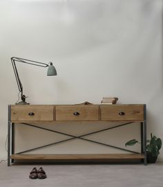 Industrial Sideboard, by KONK!  Heavy, beautiful, industrial.  Made from solid, hand selected French Oak, sanded and buffed to a  beautifully smooth finish and held together with 3mm thick mild steel and  industrial grade bolts and washers. Made by hand in Bristol.    Dimensions: L:160cm, D:30cm, H:75cm  This product can be made to any size, and with any finish on the wood. Just  send us a message with your requirements for a free quote!  (The pictured colour is 'Medium Brown', for more…