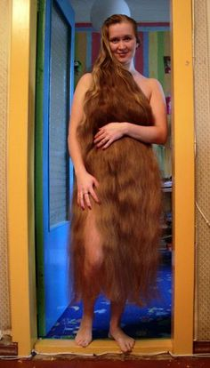 Woman with Very Long Hair - What do you think about super long hair? Cut it or keep it? -cut it its grosssss