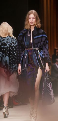 An eclectic mix of textures and fabrics in leaf motifs and geometric designs on the Burberry A/W14 runway