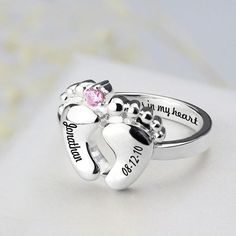 Personalized baby feet rings, the perfect silver rings to celebrate the family milestones in your lives.We carefully apply name and date of your choice to either side of the baby feet to create these beautiful, highly personal, celebration rings. More