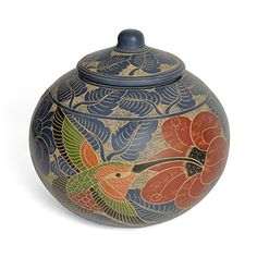 This charming artisan jar is meticulously etched and painted with hummingbird and floral motifs, and its eclectic appeal will add artistic flair throughout your home. Some of the world's most distinct