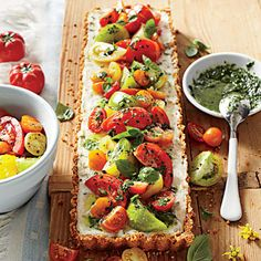 Tomato-Goat Cheese Tart with Lemon-Basil Vinaigrette | Cookbook author Sheri Castle shared her recipe, a family favorite, with us. | https://SouthernLiving.com