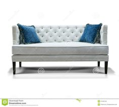 white couch blue pillows   White sofa with two blue pillows isolated on white background.