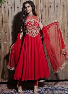 """DETAILS.  A red collared hand embroidered anarkali set with keyholes at the back. It  comes with a stretch satin churidar and embroidered cutout dupatta. The  outfit is dryclean or steam press only.  MATERIALS.  Georgette and net anarkali, net dupatta, stretch satin churdiar. The outfit  has a shantoon lining.  FIT (INCHES).  S: BUST - 34"""", WAIST - 29"""", LENGTH - 52"""" (CHURIDAR) ELASTIC WAIST - 28""""E M: BUST - 36"""", WAIST - 31"""", LENGTH - 52"""" (CHURIDAR) ELASTIC WAIST - 30""""E L: BUST - 38""""…"""