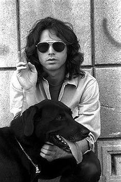 "LOVELY black labrador taking his human ""Jimmy"" for a walk. Jimmy likes to sing while he's taken for a walk. Ah.. Jim Morrison ... what a nice human for a dog to own."