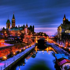 Stunning image taken in downtown Ottawa of the Rideau Canal with Parliament Hill in the distance. For more information on Ottawa visit www.ottawatourism.ca