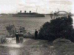 "The ""Queen Mary"" going through Bradleys Head in Sydney Harbour during WWll."
