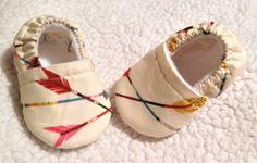 Buy Now Baby booties big arrows in cream ( prints may vary)...