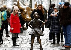 As many American women prepare to draw attention to their role in the workplace, a Wall Street firm on Tuesday put up a statue of a girl in front of Lower Manhattan's well-known bronze charging bull, as if to fearlessly stare it down. Wall Street, Charging Bull, La Face, Girl Standing, Girls Rules, Statue, Women In History, Girl Face, American Women