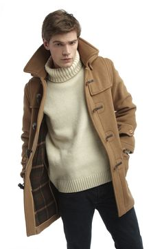Shop this look for $117:  http://lookastic.com/men/looks/camel-duffle-coat-and-beige-turtleneck-and-black-jeans/498  — Camel Duffle Coat  — Beige Turtleneck  — Black Jeans