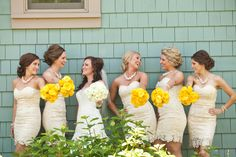 Yellow bouquets were the perfect compliment to champagne bridesmaid dresses.
