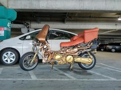 Congrats to Facebook commenter John W, who was the first to identify this crazy contraption as a naked Suzuki Burgman.