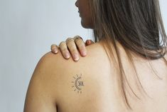 Turn your face towards the sun and let your shadows fall behind you with this minimalistic tattoo design #inkboxlove #suntattoo #naturetattoo #tattooinspiration