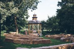 Outdoor wedding ceremony with hay bale seating