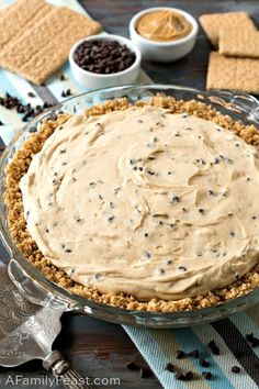 Our Chocolate Chip Peanut Butter Pie has a rich and creamy peanut butter filling with mini chocolate chips throughout. Our Chocolate Chip Peanut Butter Pie has a rich and creamy peanut butter filling with mini chocolate chips throughout. Peanut Butter Filling, Peanut Butter Desserts, Butter Pie, Köstliche Desserts, Creamy Peanut Butter, Delicious Desserts, Dessert Recipes, Yummy Food, Trifle Bowl Recipes