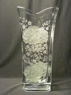 This is an Italian glass vase we cameo carved roses into.  The roses are on both sides of the vase.  This is a one of a kind piece.  We do this piece many times with the same design, but we always change some aspect of either the carving or the design.  Great gift ideas for wife, Mothers Day, Valentines Day, wedding or anniversary.  #decorativevases #decorativeglassvases