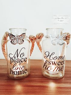 Glass jars, decorated with printed phrase, rope handle and metal butterfly attached to the neck. Jars have two verses of text - 'No Place Like Home'; and 'Home Sweet Home' and are tall. Presents For Mum, Birthday Crafts, Glass Jars, Verses, Sweet Home, Shabby Chic, Butterfly, Handle, Group