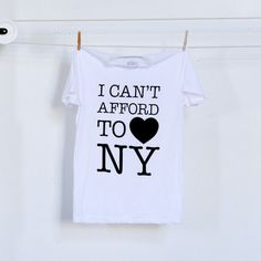 "Live from the city that sprouted the ""Rent is too damn high"" political party, the I Can't Afford To Love NY T-Shirt from Clintees is a loud statement on an inescapable fact of NYC, funneled through the iconic design. Still, it is the greatest city in the world."