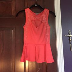 coral-orange peplum top worn only once & is in great condition (fits like a small) Charlotte Russe Tops Blouses