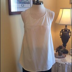 Ivory Tank NWT Lightweight and comfortable Ivory tank top. One chest pocket. Mesh detail at shoulders and back. NWT. Made by See U Soon. Size 3 which says XL. Runs small and fits medium best. See U Soon Tops Tank Tops
