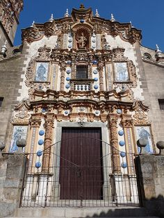 The Iglesia de San Bartolomé is an 18th century baroque church in the town of Jerez de los Caballeros in the Spanish region of Extremadura. Its exterior is exuberantly decorated with coloured ceramic tiles, bosses and ornamental pinnacles.