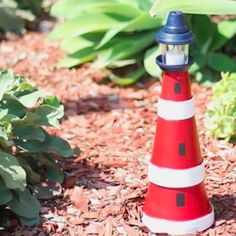 This lighthouse made from terra cotta clay pots is surprisingly easy to assemble, and it even features a lantern on top to cast a warm glow. You can place it in the garden as a decoration, or use it as a centerpiece for a beach gathering.
