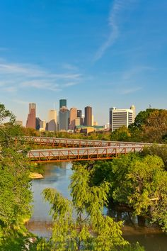 Rosemont Bridge - Houston, TX  The Rosemont Bridge connects nearby neighborhoods and provides access to Buffalo Bayou's 124 acres while creating a new tree-top view of Houston's downtown skyscrapers.