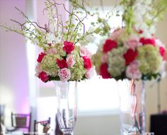 Add some color into those floral arrangements! These pop with shades of red, green and pink! www.myhautewedding.com #wedding #centerpieces #tables Photo by Infinity Weddings @Kendall Plantation