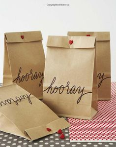 maybe little white paper bags filled with a bit of candy... easy wedding favor.