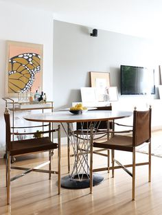 The apartment's look thoughtfully transitions from art deco to midcentury in the dining area.              ...