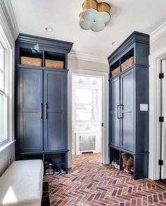 Brick paver floor in mudroom with blue cabinets and built-ins. Mudroom Cabinets, Mudroom Laundry Room, Kitchen Cabinets, Kitchen Shelves, Storage Cabinets, Cupboards, Brick Pavers, Brick Flooring, Terrazzo Flooring