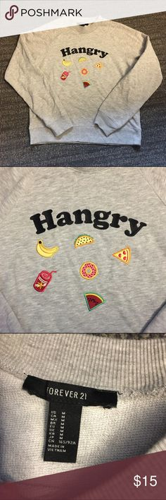 ❤️ forever 21 Hangry sweatshirt Super cute worn once f21 sweatshirt! Hangry patch is on the front surrounded by foods. Super trendy and cute! Perfect with jeans!! Size m, but is a little cropped Forever 21 Tops Sweatshirts & Hoodies