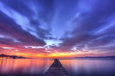 'Early' - photo by scott masterton, via Flickr;  in Platja D'Alcudia, Balearic Islands, Spain;  an HDR photo – and there is no blown pixel:  the white spot toward the center is a star