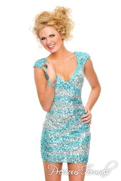 P8872 in Sky Blue/Silver, Nude/Rose (Precious Formals Diamond cutouts grace the back of this cute short dress with cap sleeves and exquisite hand sewn sequins.)