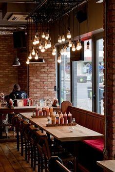 Restaurant Interior. Brick Walls. Light Bulbs . Rustic cafe love