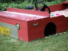 Jeep sand box with toy storage. Maybe I will paint the sand box like this.