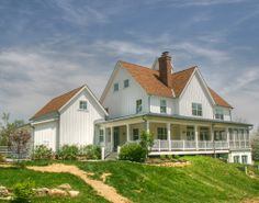 We can't get enough of farmhouses - this Gothic-Revival with a wrap-around porch is one of my favorites.  Learn more here: http://www.rtastudio.com/Portfolio/Custom%20Homes/Gothic%20Farmhouse/Gothic-Revival-Custom-Home-Alexandria-Granville-Ohio-Residential-Architect.htm