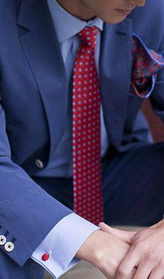 Blue suit, light blue shirt, red tie