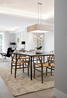 I would use a big white round or oval table with those gorgeous chairs