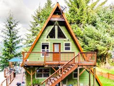 If you want to reconnect with nature, this stunning, secluded, lakefront home in Lakeside is the perfect opportunity! This rustic A-frame home is surrounded by trees and the lake, and features a private dock, two ...