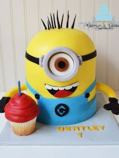 Minion Cake i love this, but fondant has to be the worst, yuck