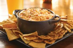 Kraft Philadelphia Buffalo Chicken Dip Recipe 1 pkg.  (8 oz.) Cream Cheese, softened   1/2 cup  KRAFT Classic Ranch Dressing 1/2 cup  FRANK'S® RedHot® Sauce 2 cups  shredded cooked chicken 1/2 cup  KRAFT Natural Blue Cheese Crumbles 1Tbsp.  finely chopped red peppers HEAT oven to 350ºF. MIX first 3 ingredients in medium bowl until blended. Stir in chicken and blue cheese.   SPOON into shallow baking dish sprayed with cooking spray.   BAKE 20 min. or until heated through; stir.