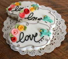 Elegant rose and birdie cookies - by Sweet Sugar Belle. We have a friend who just got engaged...so sweet!