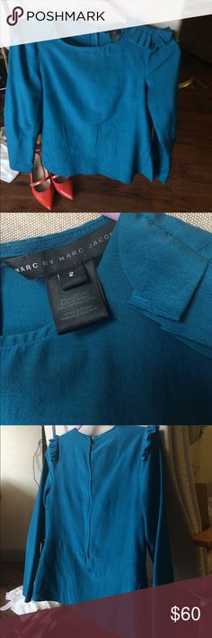 Marc Jacobs silk/cotton blouse Amazing turquoise blue color, this has been worn often with tons of compliments every time! It's one of my favorite shirts, so it's been well cared for with no snags. A little wrinkled in the middle because I wore it tucked into a pencil skirt Marc by Marc Jacobs Tops Blouses