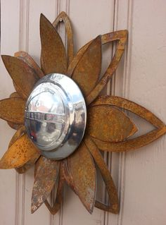 Rusted metal lotus flower wall hanger with Dodge hubcap yard art by MyRustedRoots, needs a harley davidson crest not a dodge Metal Wall Art Decor, Metal Yard Art, Metal Tree Wall Art, Metal Art, Rusted Metal, Junk Art, Colorful Wall Art, Metal Flowers, Flower Wall