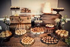 Gorgeous dessert table, designed by Jenny Cookies Baked Goods & Sweet Treats. (Photo Credit: Heather Lynn Photographie)