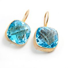 @Overstock.com.com.com - 18k Gold plated Silver Blue Topaz Earrings (India) - These posh blue topaz earrings have the high-end appeal of accessories made just for you. Set into brushed gold plated metal, the gorgeously faceted stones are allowed to dazzle everyone who sees them.  http://www.overstock.com/Worldstock-Fair-Trade/18k-Gold-plated-Silver-Blue-Topaz-Earrings-India/6417104/product.html?CID=214117 CAD              121.12