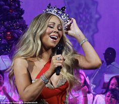 The queen: The so-called 'Queen of Christmas' wore a tiara while singing